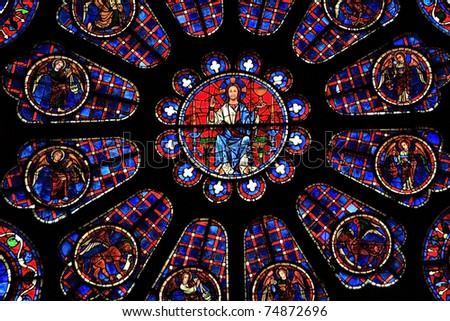 A detail of Jesus Christ from one of the stained glass windows in Chartres Cathedral, France - stock photo