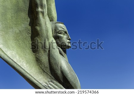 A detail of one of the two Winged Figures of the Republic on the Nevada side of the Hoover Dam.  - stock photo