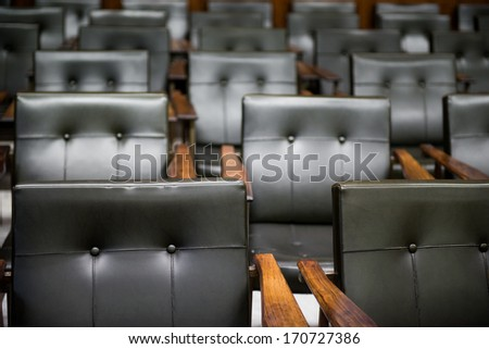 A detail shot of a meeting room chairs - stock photo
