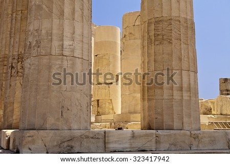 A detail view of a set of pillars at the Parthenon in Athens glowing with reflections of the white marble in the mid-day light. - stock photo