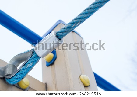 A detailed closeup macro of a rope mooring line fastened to a cleat. - stock photo
