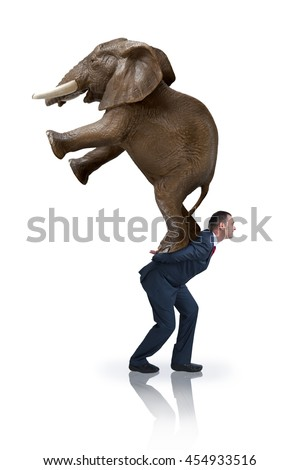 a determined strong businessman carrying an elephant on his back  - stock photo