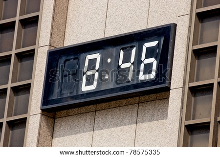 a digital clock on wall  shows the time in taipei - stock photo