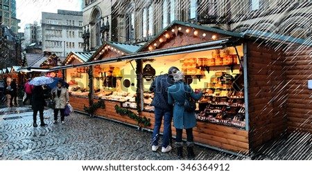 A digital illustration of the Christmas market in front of the Manchester Town Hall, England, UK in the rain - stock photo