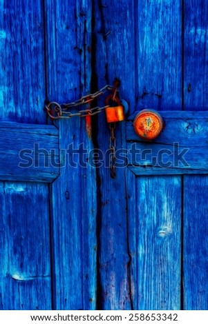 A digitally constructed painting of a padlocked blue wooden door - stock photo