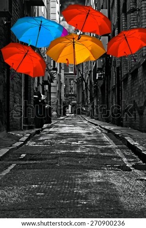 A digitally constructed painting of colorful umbrellas in a dark back street alley - stock photo