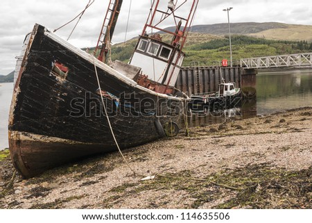 A dilapidated rotting trawler towed in to Corran from its partially sunken position approx. 1 mile further up Loch Linnhe. - stock photo