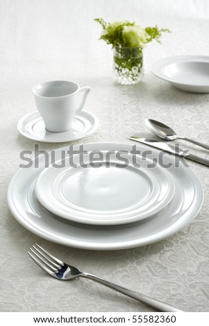 A dinner plate, knife and fork - stock photo