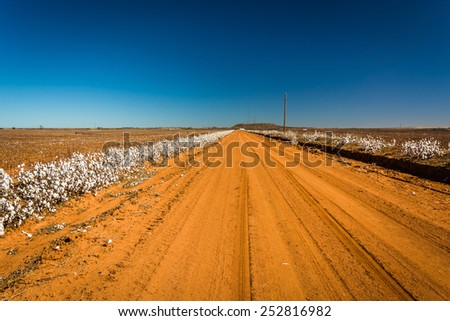 A dirt road near Memphis, Texas. - stock photo