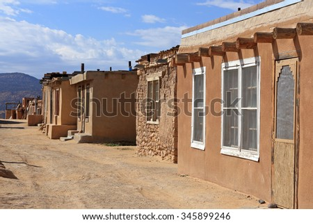 A dirt road with buildings at the Acoma Pueblo in New Mexico. - stock photo