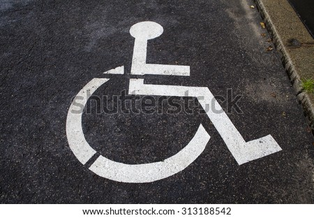 A Disabled Parking Space. - stock photo