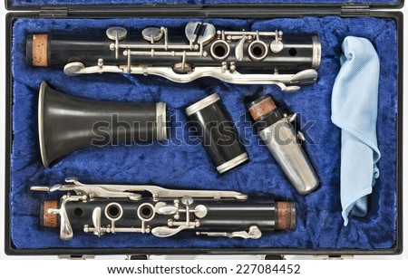 a disassembled clarinet in a blue box