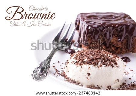 A dish of brownies and a ice cream and dessert fork on white background - stock photo