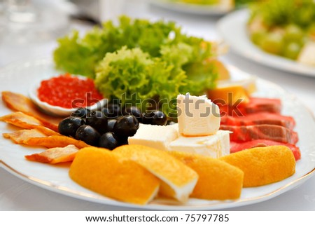 a dish of caviar and olives - stock photo
