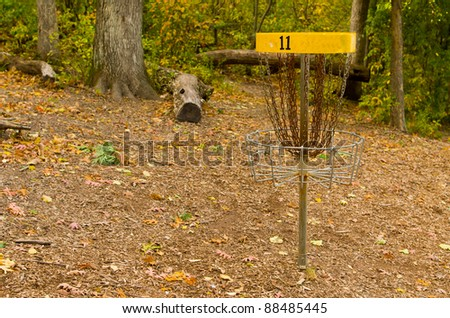 A Disk Golf Chain Catcher in a Wooded Golf Course - stock photo