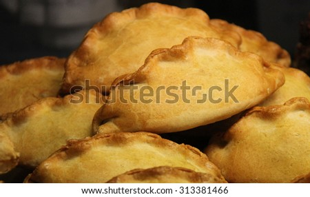 A Display of Freshly Baked Cornish Pasties. - stock photo