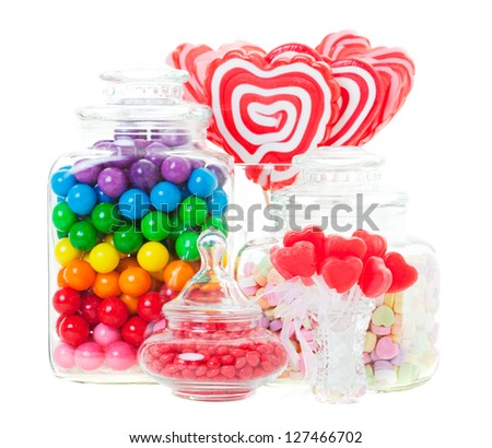 A display of various candies in glass containers.  Shot on white background. - stock photo