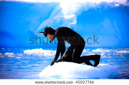 A diver on the ice - stock photo