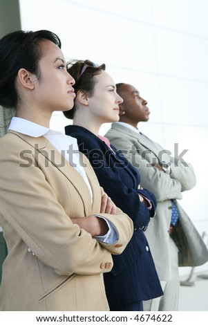 A diverse attractive business team at their company - stock photo