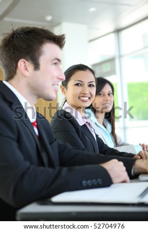 A diverse attractive man and woman business team at meeting - stock photo