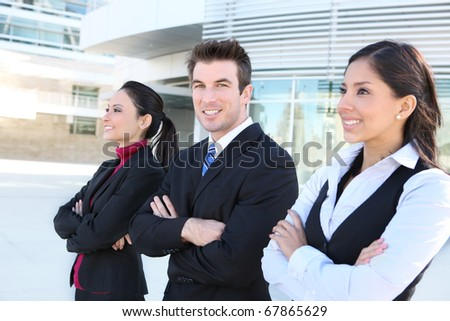 A diverse attractive man and woman business team at office building - stock photo