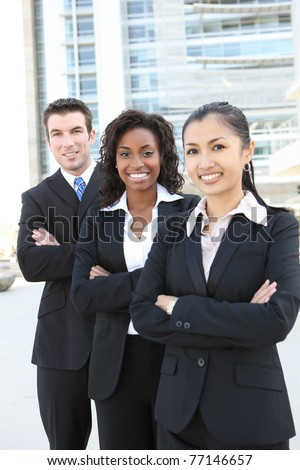A diverse attractive man and woman business team (FOCUS ON MIDDLE WOMAN) - stock photo
