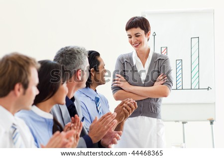 A diverse business group applauding a good presentation against a white background - stock photo