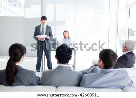 A diverse business people at a conference in an office - stock photo