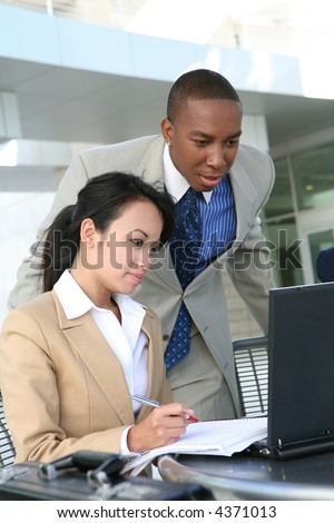A diverse business team working on a laptop computer