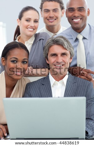 A diverse business team working with a laptop in a meeting