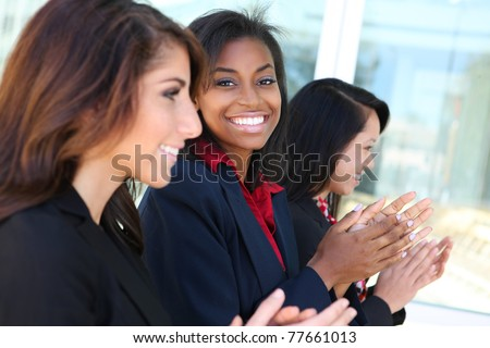 A diverse business woman team clapping at presentation
