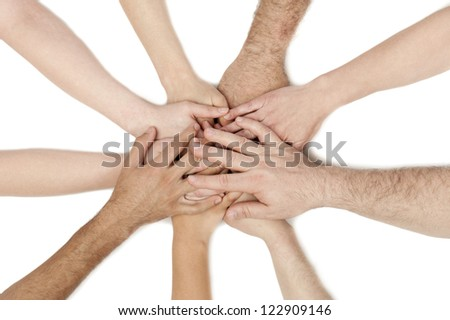 A diverse group of business workers with their hands together in form of teamwork and unity