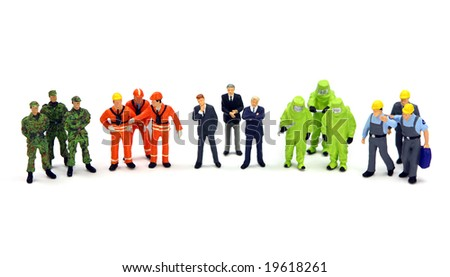 A diverse group of workers standing in a row against a white background. Diversity or teamwork concept. - stock photo