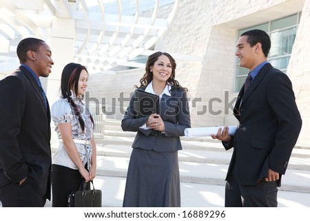A diverse young man and woman business team at office building - stock photo