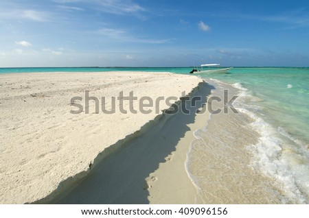 A diving boat on a desert beach in Los Roques Venezuela.