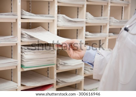 A doctor checking a record card of patients. hospital. medical check.  - stock photo