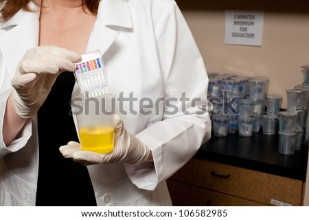 A doctor holding a urine sample