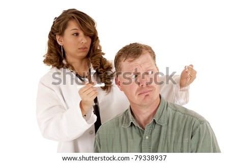 a doctor is shining a light through her patients ears.  They both have shocked expressions on their faces. - stock photo