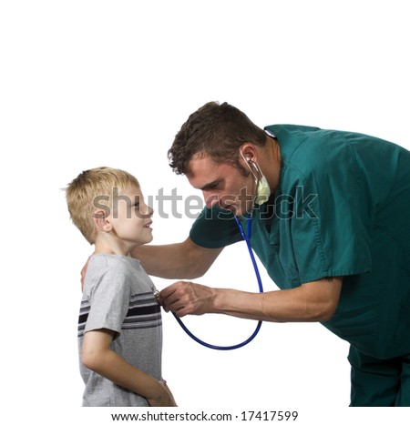 A doctor listens to a young patients heart