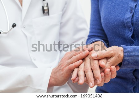 A doctor showing feelings of support towards his patient