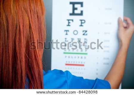 a doctor watching a test for eye examination - stock photo