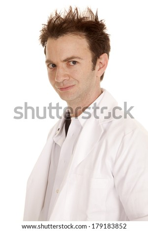 A doctor with crazy hair standing and looking - stock photo