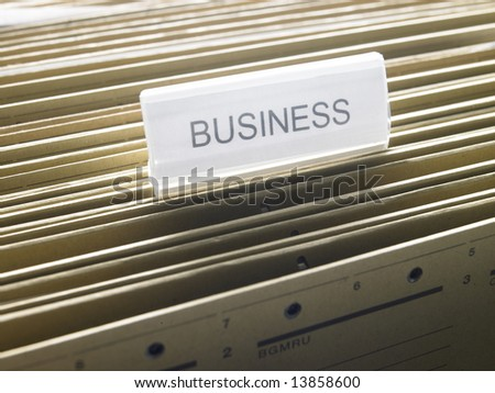 "a document cabinet with a folder called ""Business"""