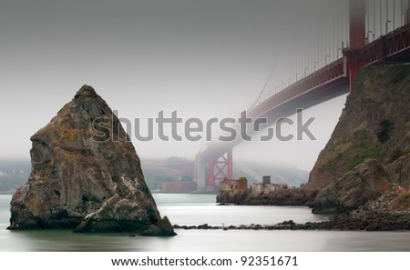 A documentary about the Golden Gate Bridge of San Francisco, seen under a different perspective and through its summer fog - stock photo