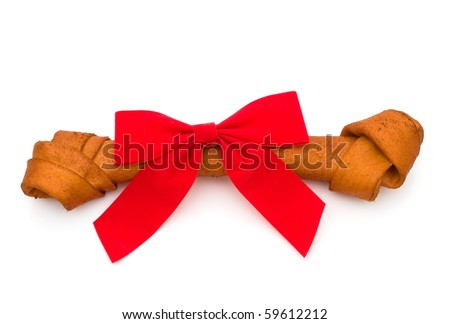 A dog bone with a bow isolated on a white background, Dog treat - stock photo