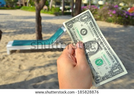 a dollar in business man's hand on holiday