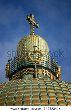 A dome with a cross A dome with a cross from an art nouveau church.  - stock photo