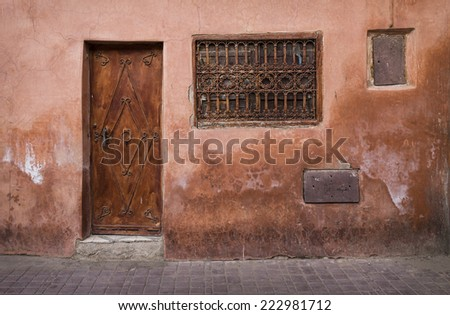 A door an a window in the Medina of Marrakesh, Morocco, North Africa - stock photo