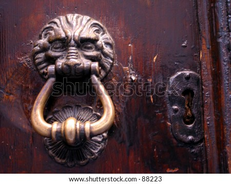 A door knob with a key hole on an ancient door in Rome italy - stock photo
