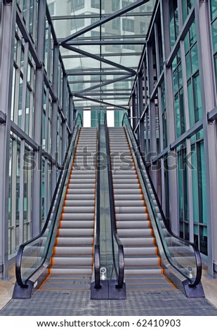 A double escalator conveyor staircase in a futuristic modern building. - stock photo